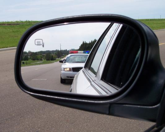 TRAFFIC-POLICE-in-car-mirror